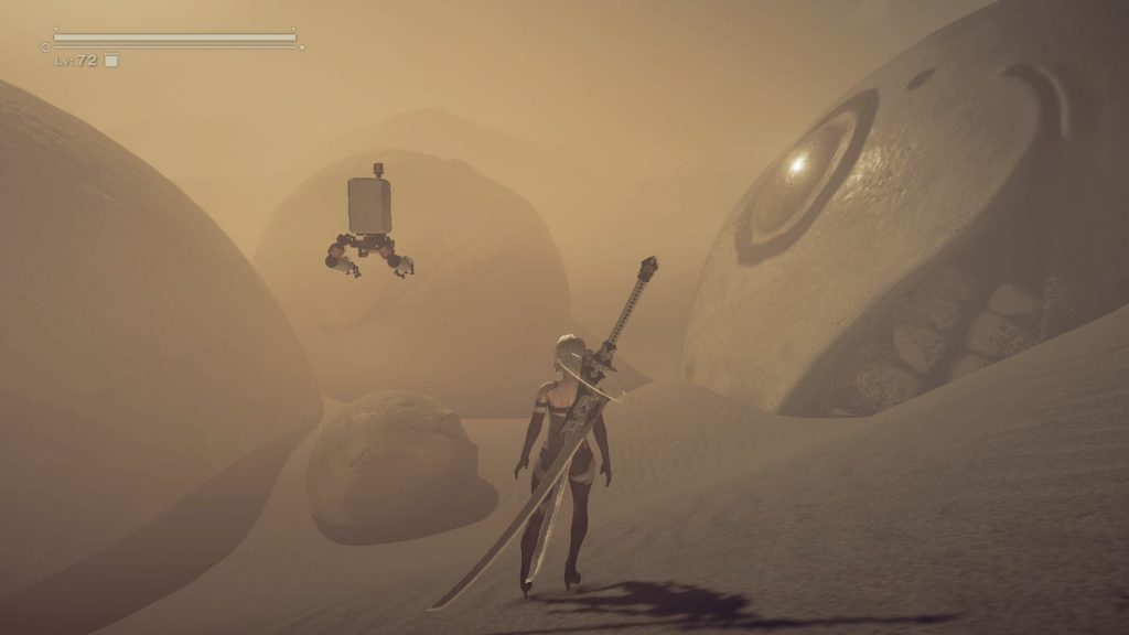 A2 in the desert among giant Emil's heads